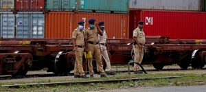 India in particular has been hit hard by the pandemic: security guards in front of freight containers in Bangalore.