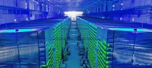 A worker inspects a Bitcoin farm in Russia.