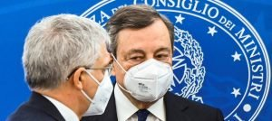 Italy's Prime Minister Mario Draghi (right) and his Treasury and Finance Minister Daniele Franco