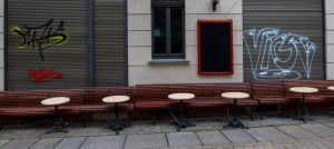 Empty tables and benches stand in front of a pub in the old town of Halle / Saale.